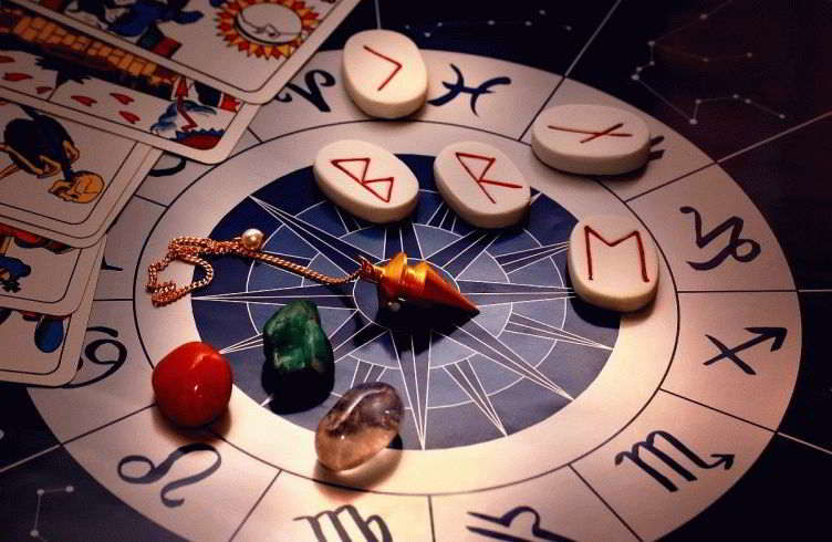 zodiac with runes, healing stones, magic pendulum and tarots in mystical lightining
