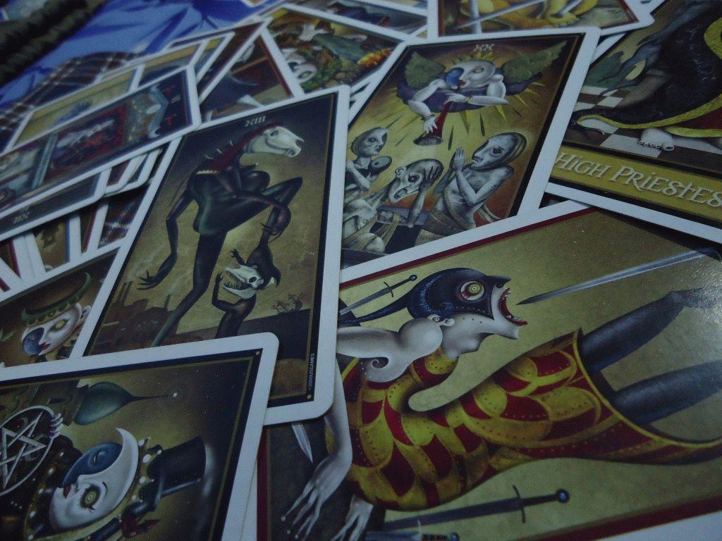 Карта Таро Семёрка Мечей — значение, толкование и расклады в гадании